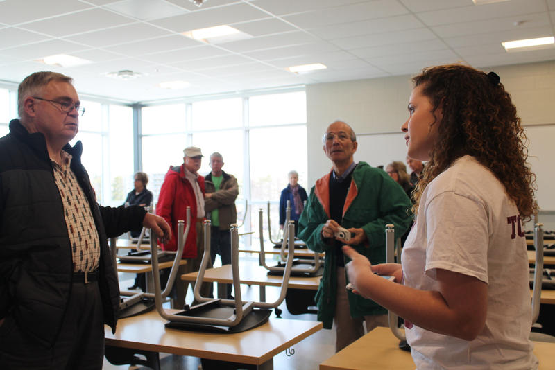 State High junior Isabella Rater leads a tour through one of the new classrooms.