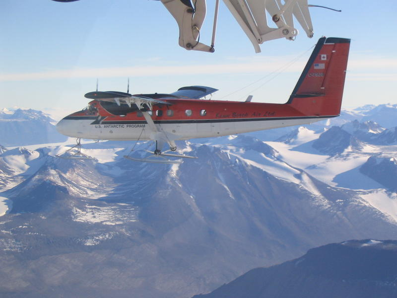 Twin Otter flying in formation over the Dry Valleys on return from the Polar Plateau deploying two seismic stations for the TAMSEIS Project.