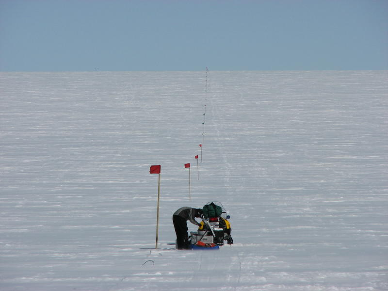 Researchers working on the seismic line in Jakobshavn Glacier, Greenland.