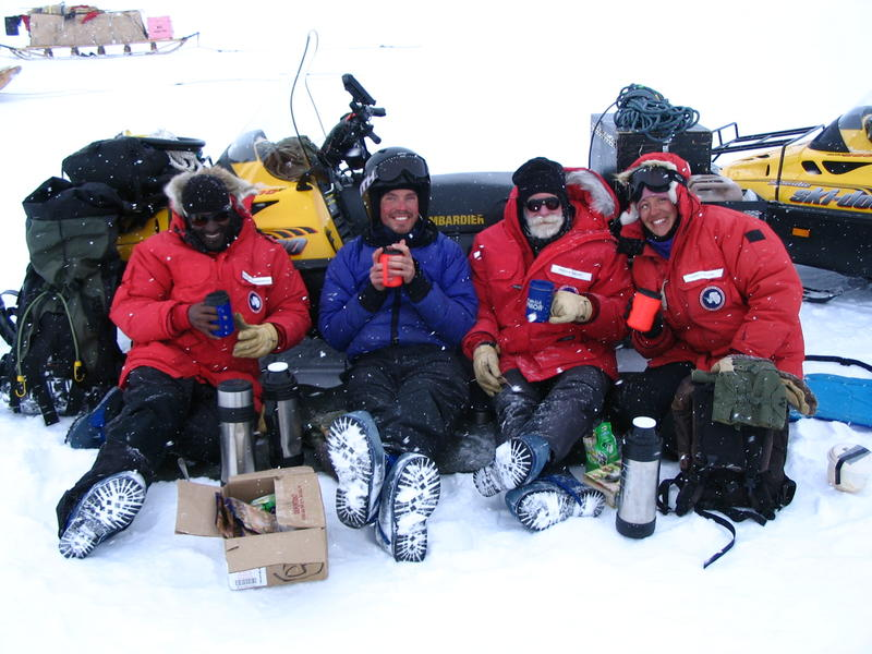 Don Voigt, Drs. Sridhar Anandakrishnan, Huw Horgan, and Ginny Catania grab some dinner during a late night snowmobile traverse on Whillans Ice Stream, Antarctica.