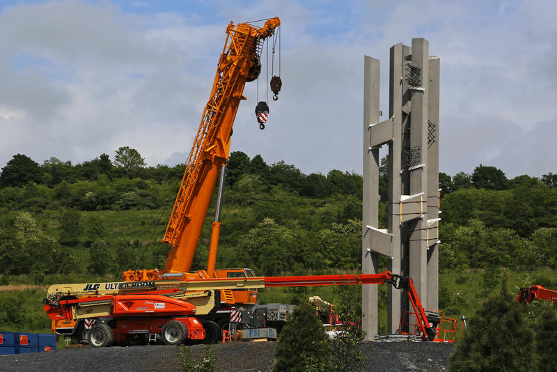 This May 31, 2018, photo shows the first section of the 93-foot tall Tower of Voices wind chimes is in place at the Flight 93 National Memorial in Shanksville, Pa. The final phase of the memorial is on track to open on Sept. 11, 2018.