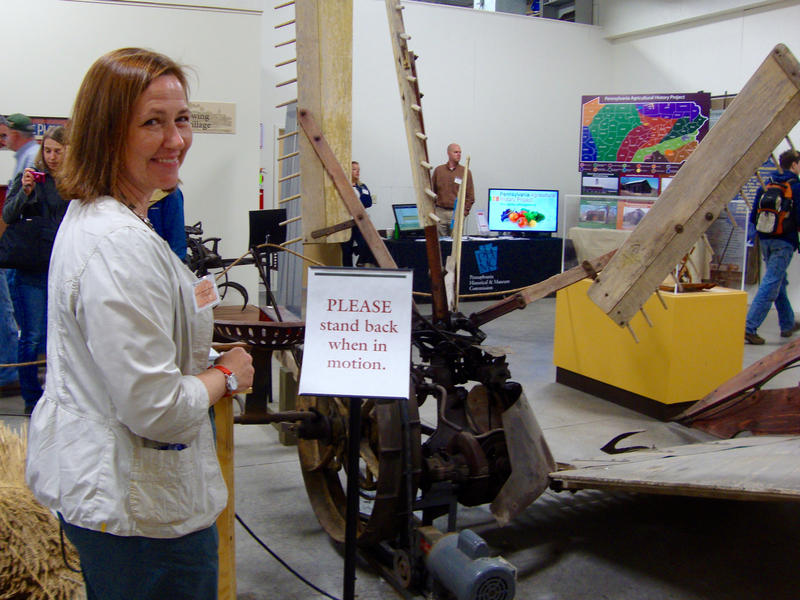 Curator of the Pasto Agricultural Museum, Rita Graef, shows off some of the museum's antique farm equipment.