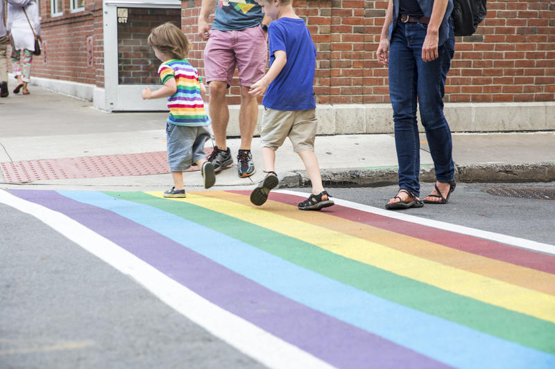"Rebecca Lundin watched her two sons, Alex and Cam, who are playing on the rainbow crosswalks.  ""I think if they're raised knowing that same sex relationships are okay, then they just know that it's okay,"" she said."