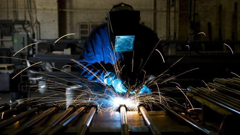 In this file photo, a welder fabricates anchor bolts for roads and bridges at the custom manufacturer in Pennsylvania.