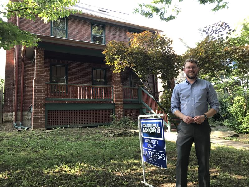 State College borough planning director Ed LeClear in front of one of the houses sold through the Neighborhood Sustainability Program.