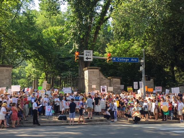 "A large crowd braved the heat at the ""Families Belong Together"" rally."