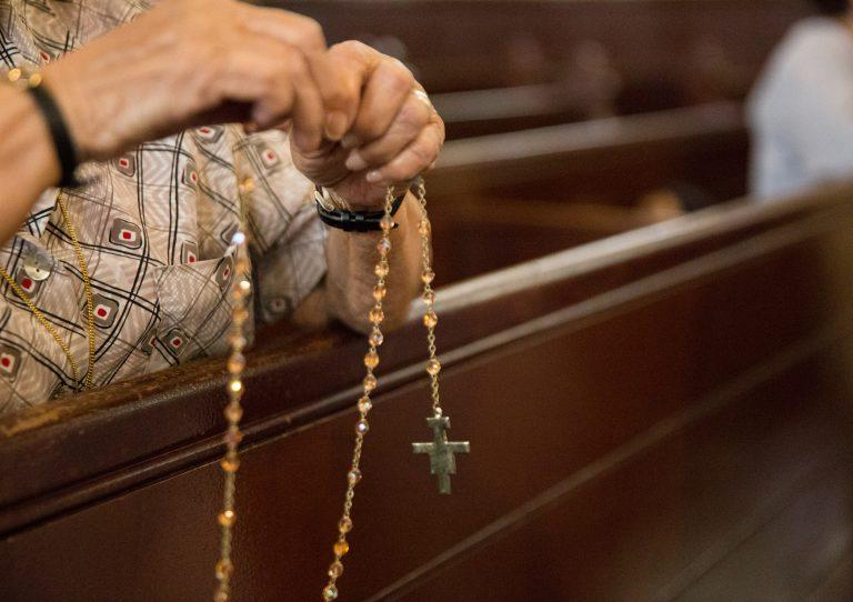 Parishioners pray the Rosary at Holy Infancy Roman Catholic in Bethlehem, Pennsylvania after mass on Tuesday, August 14, 2018.
