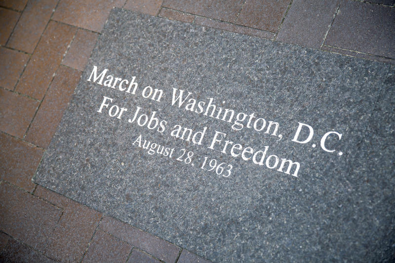A plaque commemorates the March on Washington, D.C. for Jobs and Freedom at the Martin Luther King Jr. Plaza on Fraser Street.