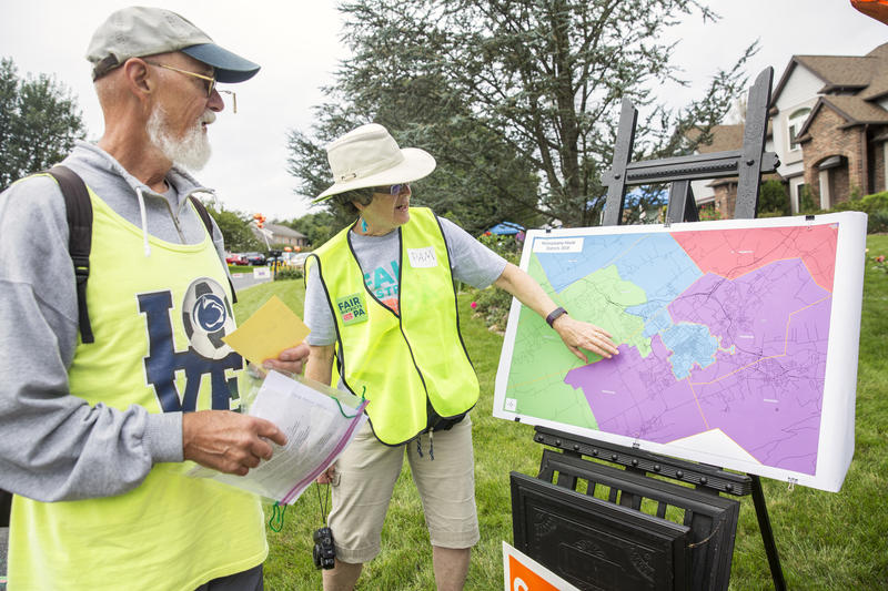 "Fair Districts PA organizer Pam Short shows a participant in the ""Gerry Meander"" walk which district they are standing in. The 2.5 miles participants walked covers three Pennsylvania House Districts and two U.S. House Districts."