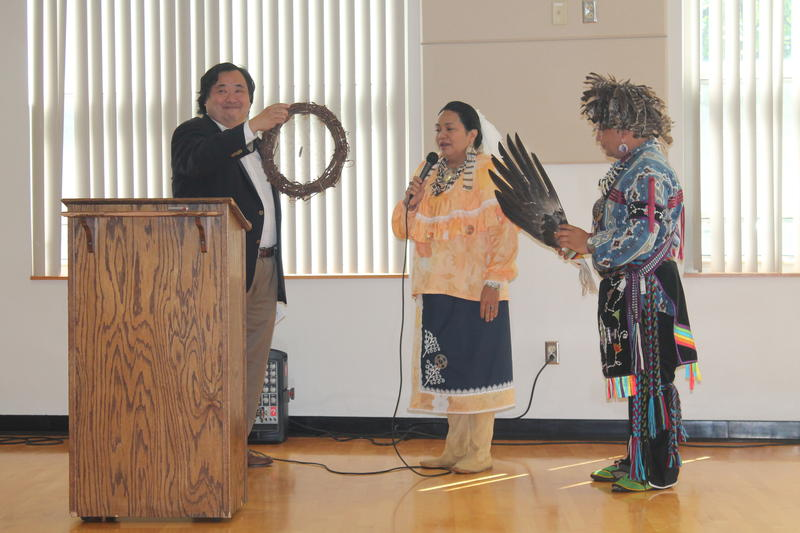 State College Mayor Don Hahn accepts a dreamcatcher from Emelie Jeffries and Patrick Littlewolf Brooks.