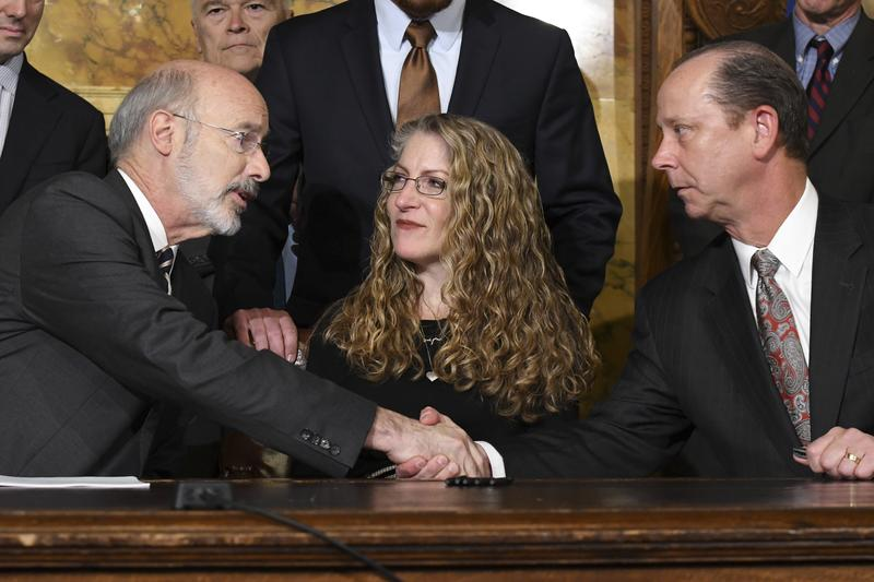 On Friday, Oct. 19, 2018 in Harrisburg, Pa., Pennsylvania Gov. Tom Wolf shakes hands with Jim Piazza after signing anti-hazing legislation inspired by the death of Piazza's son, Penn State student Tim Piazza.