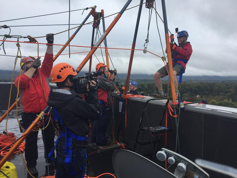 Participants prepare to rappel down the 155-foot-tall Fraser Center for