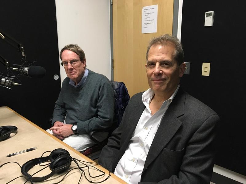 Two men sitting in radio studio