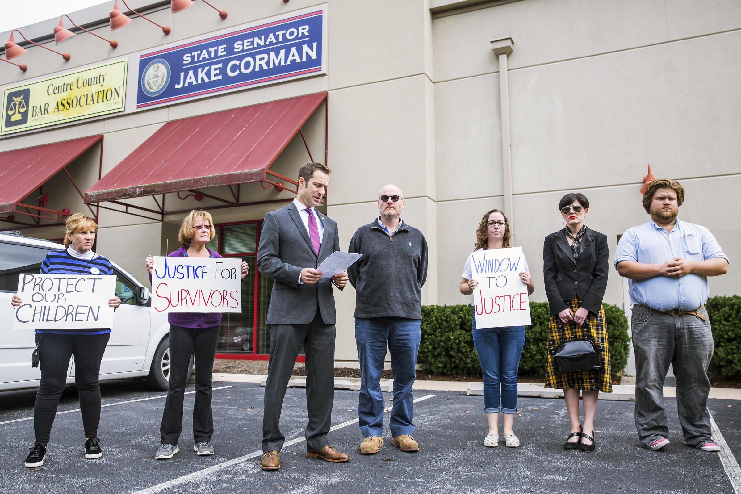 Advocates spoke outside Corman's Bellefonte office on Friday.