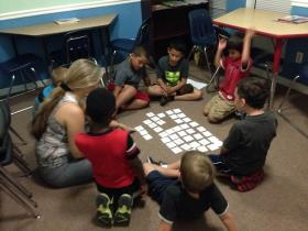 Teacher Nancy Allen doing a word activity with the students at the Boys and Girls Club in Hobe Sound.