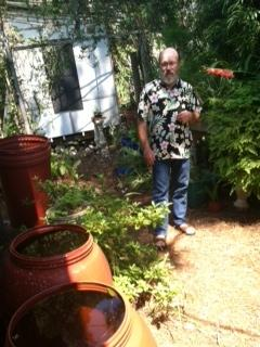 Elwood Holzworth has rain barrels in his back yard.