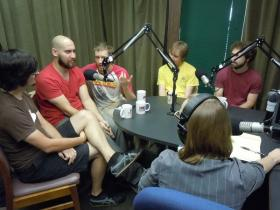 Prom Date in the studio with WRKF's Amy Jeffries: from left to right, Nick Boudreau, Brett Burke, Dave Fuller, James West, and Steven Landry. (WRKF/Claire Ohlsen)