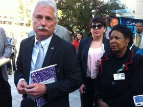 Louisiana Federation of Teachers president Steve Monaghan (far left) speaking with reporters outside the state courthouse in Baton Rouge, Dec. 18, 2012.