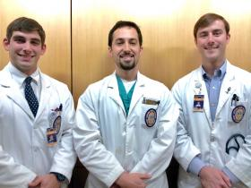 (L to R) Third-year LSU medical students Matt Landrum and Dan Logsdon with fourth-year medical student, Clark Alsfeld.