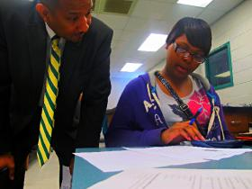 Josey High School principal Ronald Wiggins helps students in Shannon Moore's chemistry class.