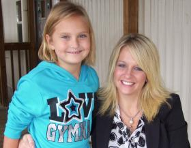 "Inskip Principal Elisa Luna with third grade student Sarah Lawrence. ""It's a good school,"" Lawrence says. ""It's gonna take me to good places –- like good colleges, and good places to work."""