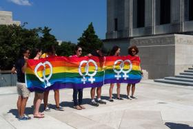 FILE: A group from Baton Rouge's L Bar holds up a pride banner at the capitol, June 23, 2012. 
