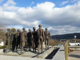 """Statues of the """"Clinton 12″ look out over downtown Clinton, TN."""