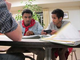 Micky Zegaye (left) works with a tutor at Fugee Academy in Clarkston, GA.