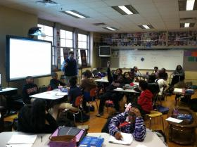 Phillips Academy seventh-grade social studies teacher JohnMark Edwards delivers a lesson on the world's different types of economies.