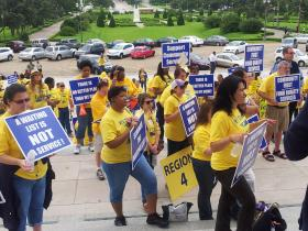 Decked out in yellow shirts, proponents of community-based waiver supports for the developmentally disabled rallied at the state capitol.