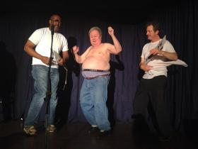Advocate columnist Smiley Anders center stage and partially disrobed during rehearsal for Gridiron 2014.