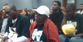 Workers await their time to testify on minimum wage bills.