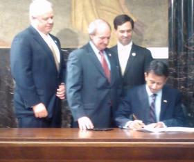 Bill signing on final day of 2014 session. From left to right: House Speaker Chuck Kleckley, Senator Robert Adley, Rep. Neil Abramson, Governor Bobby Jindal