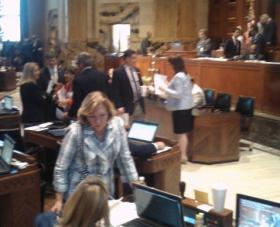 Lawmakers aren't chatting about their post-session plans here. They're working out compromises on bills.