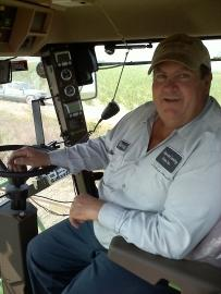 Danny Landrieu drives a sugar combine in Paincourtville. (Tegan Wendland/WRKF)