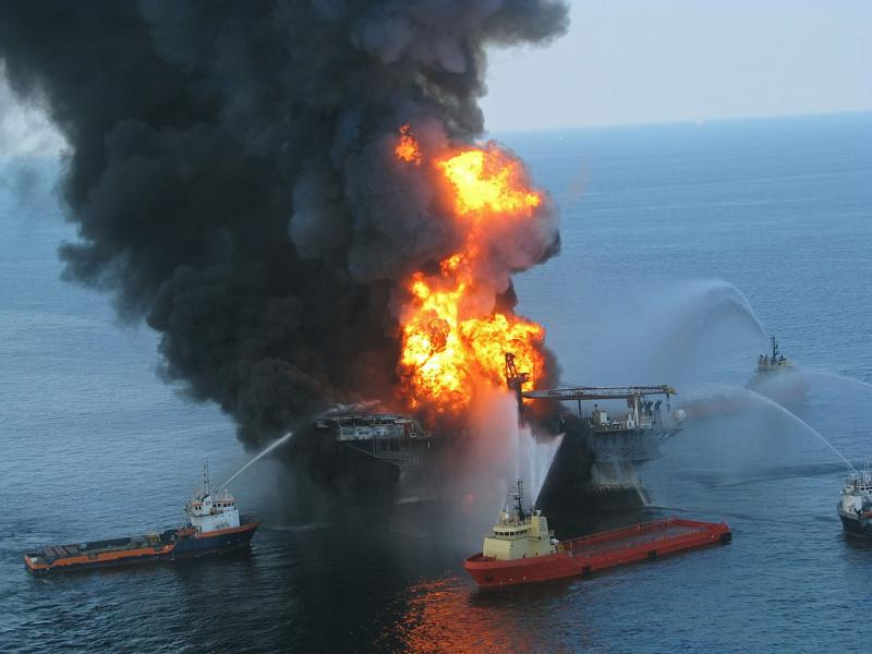 Platform supply vessels battle the blazing remnants of the off shore oil rig Deepwater Horizon, April, 20, 2010.