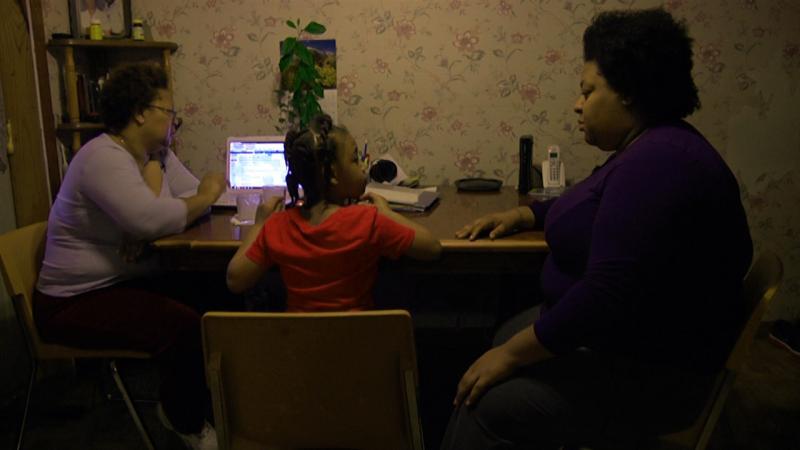 Angela Merritt, with daughters Gabby and Larasha, is working to reintegrate Tate County Schools.