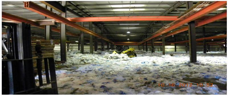 Bags of ice ordered for Hurricane Isaac melting in a Lacombe, La. warehouse.