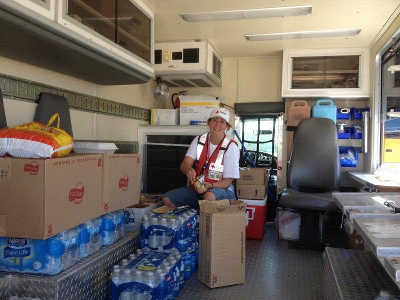 Kathy stocks food and water inside the Emergency Response Vehicle.