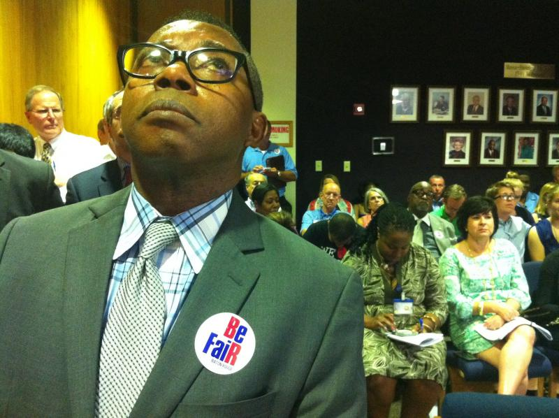 "Barrington Neil, who spoke of experiencing discrimination for being in an interracial marriage, listens to the hearing on the ""Fairness Ordinance"" at the Baton Rouge Metro Council meeting, July 23, 2014."