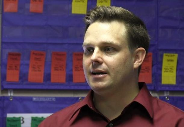"Headmaster Josh LaSage in Hosanna Christian Academy's in 2012 in ""war room"" where the student progress is tracked."