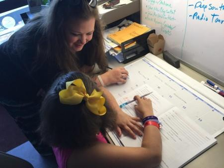 Anna Davis of Picayune and her daughter Isabel doing everyday school work.