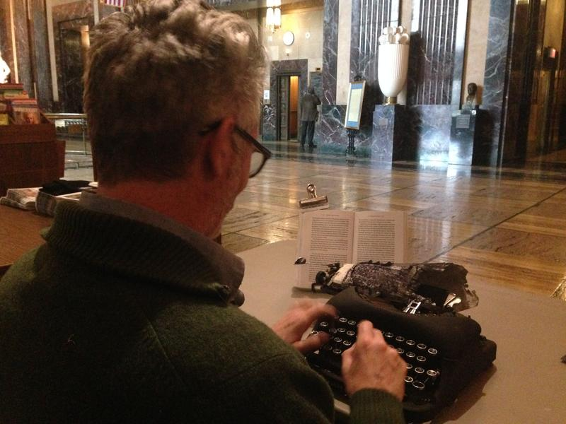 Artist Tim Youd re-typing 'All the King's Men' inside the State Capitol