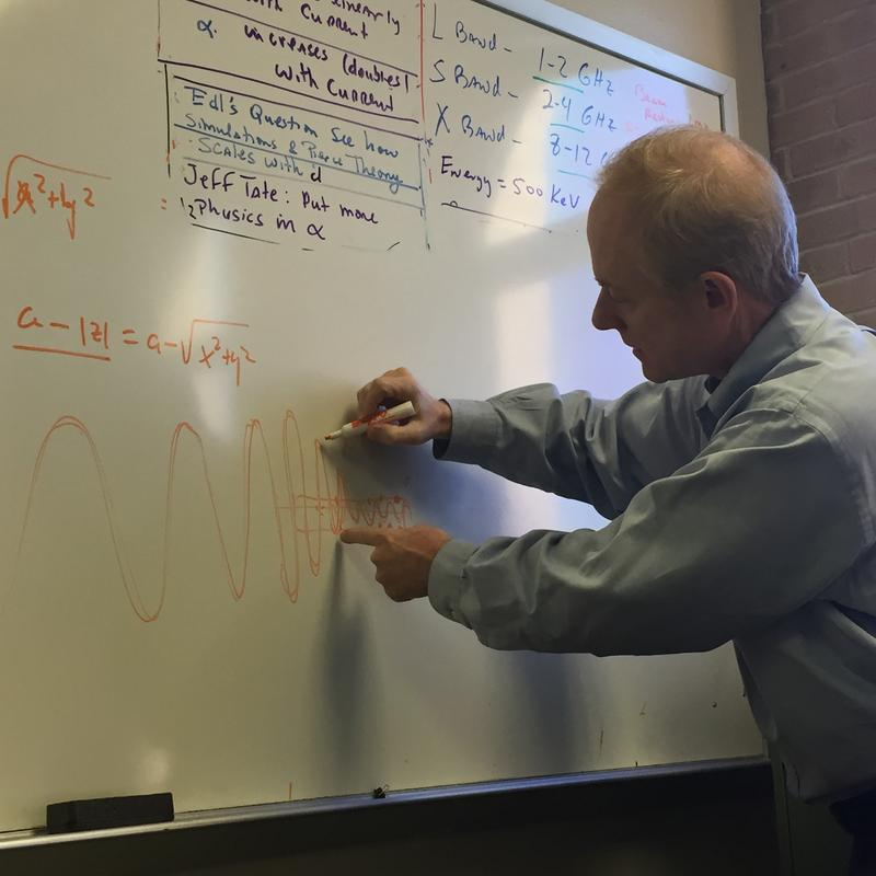 Dr. Robert Lipton illustrating how the Microwave Amplifier tube works.