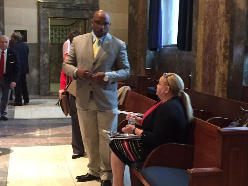 Troy Brown and his lawyer Jill Craft await start of Senate meeting