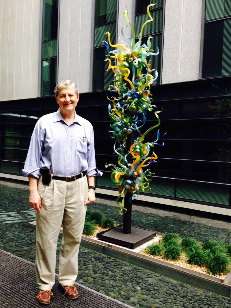 John Kennedy stands next to glass sculpture at UMC-New Orleans