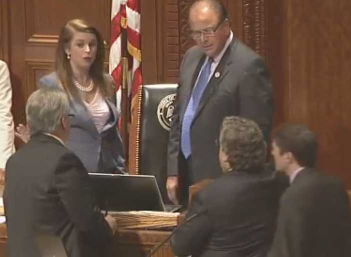 Julie Stokes confers with Speaker and House Clerk