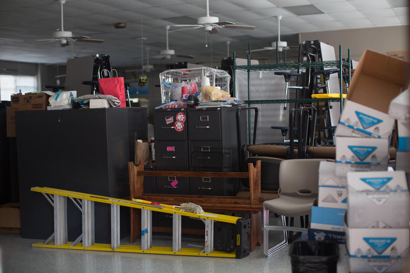 Desks, chairs and cabinets sit in Freshwater Elementary's cafeteria, making room for repair work in classrooms.  The school took on two feet of water in the August flood.