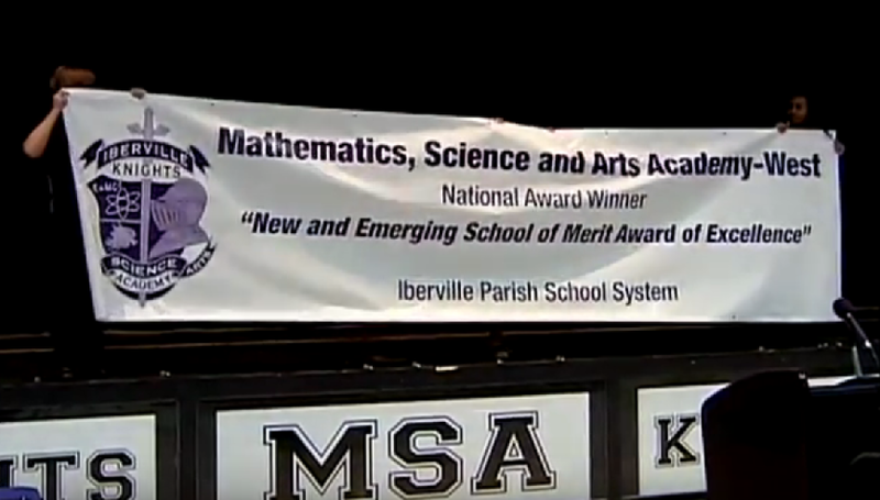 Iberville Magnet students unveil award banner