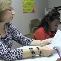 Beverly Ortego, an interventionist at Hosanna Christian Academy, with a reading student.
